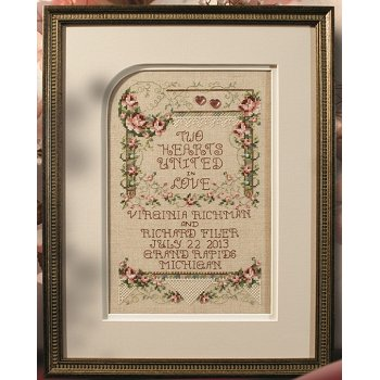 Photo of framed cross stitch Two Hearts wedding THUMBNAIL
