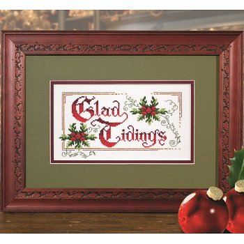 Photo of framed cross stitch Glad Tidings
