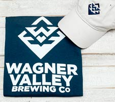Navy blue t-shirt witha white Wagner Valley Brewing Co logo and a white baseball cap with a navy blue logo on the front