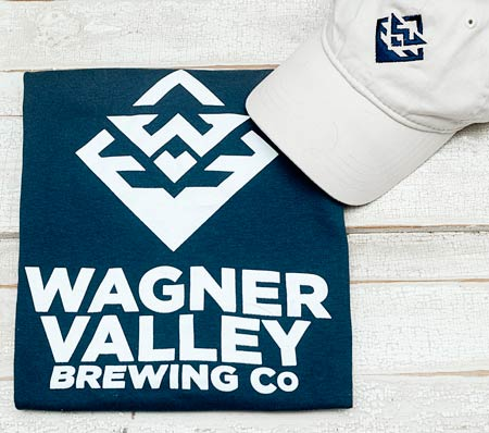 Navy blue t-shirt witha white Wagner Valley Brewing Co logo and a white baseball cap with a navy blue logo on the front_MAIN